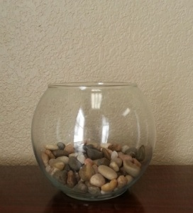 glass bowl with river rocks