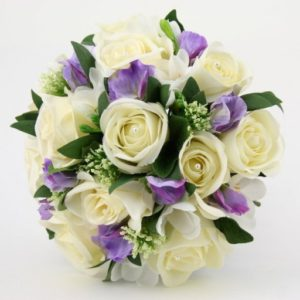 11 flower arrangements for your wedding season georgetown event center handtied of ivory roses and red tulips white daisies lilac sweet pea calla lilies bouquet and blue hydrangeas bouquet mightylinksfo
